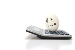 Upsetting egg on the electronic calculator Stock Photography