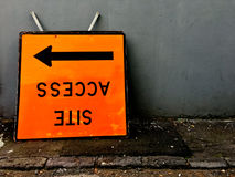 Upside down access site sign with arrow Stock Image