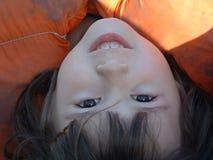 Upside-down beauty. Upside-down girl wearing weathered life jacket stock photo