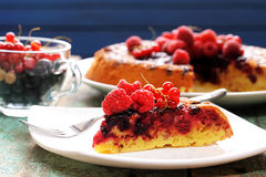 Upside down berry cake with fresh raspberries and currants. Closeup Royalty Free Stock Photography