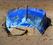Upside down boat. Upside down blue boat on Staithes beach Royalty Free Stock Photography