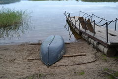 The upside-down boat. Drying on the banks of the river Stock Images
