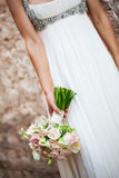 Upside down bouquet. A cropped image of a bride holding her bouquet of roses upside down in her hand Stock Photos