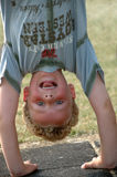Upside Down Boy. Boy standing upside down in a handstand royalty free stock image
