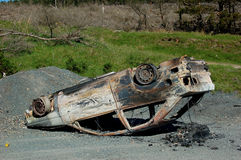 Upside down burnt-out car Stock Images