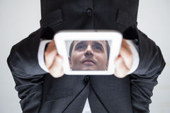 Upside down businessman with digital tablet Royalty Free Stock Image