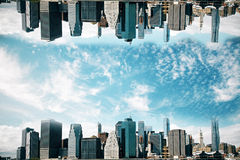 Upside down cityscape. Abstract upside down cityscape  on sky background. Wallpaper/backdrop with copy space Stock Image
