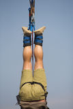 Upside down. A close up of a man hanging upside down after bungee jumping royalty free stock photography