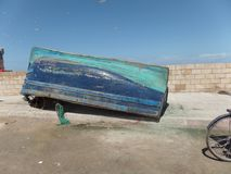 Upside down fishing boat by the harbour in Essaouira, Morocco stock images
