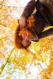 Upside down ginger hair girl. Stock Photos
