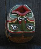 Upside down green and red totem face royalty free stock photography
