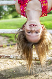 Smiling Girl hanging upside down  Royalty Free Stock Photo