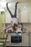 Upside down House. Little girl on the kitchen Stock Image