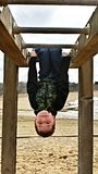 Upside down!. This little boy is having fun at the monkey bars, swinging and hanging upside down. Happy face Royalty Free Stock Image