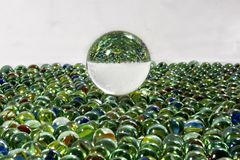 Upside down marbles stock image