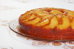 Upside down pear cake on glass plate Royalty Free Stock Images