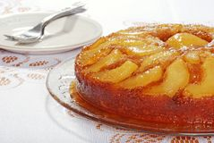 Upside down pear cake with plates and forks Stock Photography