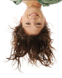 Upside-Down Portrait. A head portrait of an attractive young teen in an upside-down position. On a white background stock photo