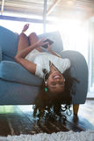 Upside down portrait of girl relaxing on armchair Stock Image