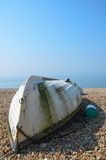 Upside down rowing boat on a beach Royalty Free Stock Photography