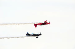 Upside down stunt plane Royalty Free Stock Photography