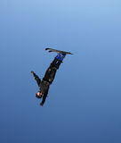Upside down twist. A freestyle aerialist flies and flips on skis Stock Photos