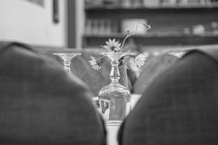 Upside Down Wine Glass Behind the Flower Grayscale Photo royalty free stock image