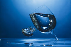 Upside down wine glass under water. Abstract shot of upside down wine glass under water pouring air bubble Royalty Free Stock Images