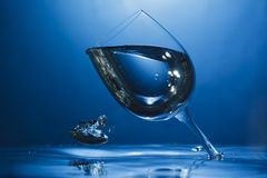 Upside down wine glass under water. Abstract shot of upside down wine glass under water pouring air bubble Stock Image