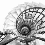 Upside view of indoor spiral winding staircase with black metal ornamental handrail. Architectural detail in St. Stephen`s Basilica in Budapest, Hungary. Black Royalty Free Stock Images