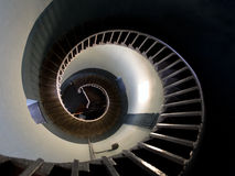 Upside view into the spiral of a lighthouse Stock Photo