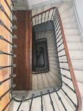 Upside view of a spiral staircase angle shot bike downstairs old french entrance stock photos