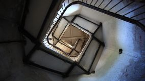 Upside view of spiral stairway case in lighthouse. HD. 1920x1080 stock video footage