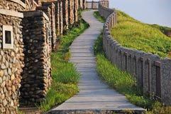 An upslope path to a sea shore hill at Hoping island, Keelung, Taiwan stock photos