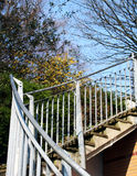 Upstairs. With bannister, blue sky, trees and plants royalty free stock images