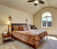 Upstairs bedroom with vaulted ceiling and arch window Royalty Free Stock Images