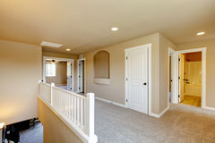 Upstairs hallway in big house with beige interior paint. Stock Image