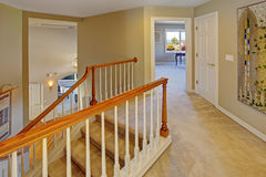 Upstairs hallway with staircase Stock Photos