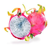 Upstanding full and half-cut Dragon fruit Stock Image