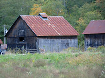 Upstate New York farm buildings with rusted roofs and greyed walls Royalty Free Stock Images