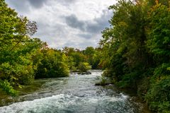 Upstream river of Niagara falls. NY, USA. Colorful trees on the background Royalty Free Stock Image