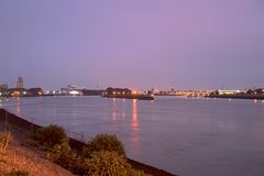 Upstream view of river Weser at night. With industry and city lights of Bremen skyline Royalty Free Stock Photos
