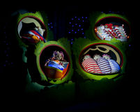 Upsydaisy, makka pakka, tombliboos and pontipines in bed ready to sleep Stock Photos
