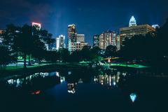 The Uptown skyline and a lake at Marshall Park at night, in Char. Lotte, North Carolina Royalty Free Stock Photos