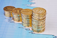 Uptrend stacks coins,on the financial stock chart Royalty Free Stock Images