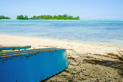 Upturned boat on beach. Royalty Free Stock Images