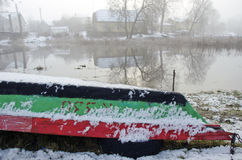 Upturned boat by the river in winter time Stock Image