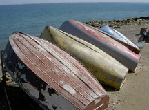 Upturned boats. Old boats Stock Images