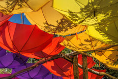 Upturned brightly colored umbrellas Stock Image