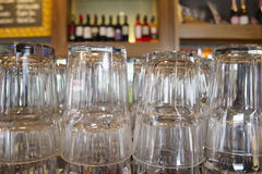 Upturned glasses at a pub counter Royalty Free Stock Image